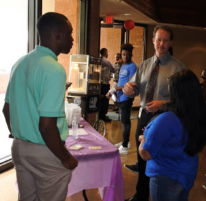 Dr. Hurst talks with students.