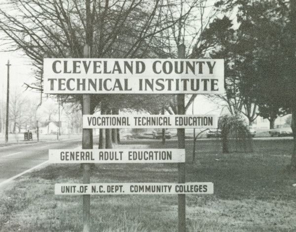 In October 1967, the Cleveland County Unit of Gaston College gained independence and officially became Cleveland Technical Institute. In late summer and fall of 1969, the Institute moved to new quarters on South Post Road and began operating in the former County Home buildings. This sign on Post Road indicates the focus of the Institute at that time. From the beginning, the College was a member of the North Carolina Department of Community Colleges, which is now the North Carolina Community College System.